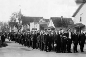 Church at Fourth and Madison in the background.  The congregation ready to head up Monroe to their new church building. 1924